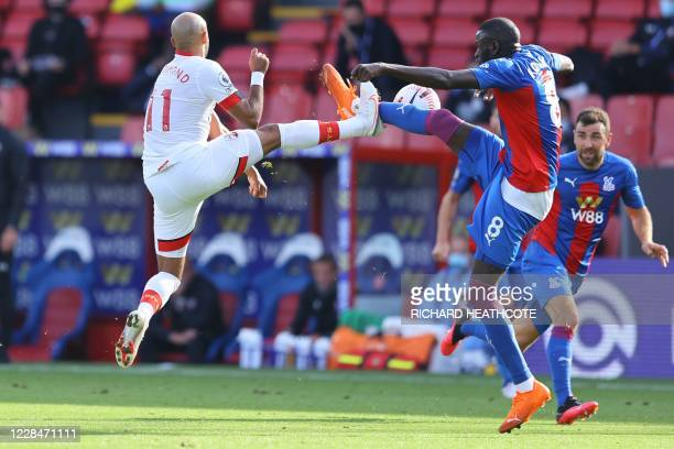Southampton's English midfielder Nathan Redmond vies with Crystal Palace's Senegalese midfielder Cheikhou Kouyate during the English Premier League...