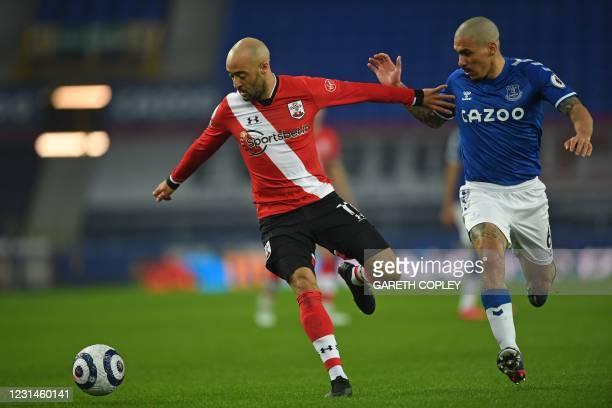 Southampton's English midfielder Nathan Redmond vies with Everton's Brazilian midfielder Allan during the English Premier League football match...