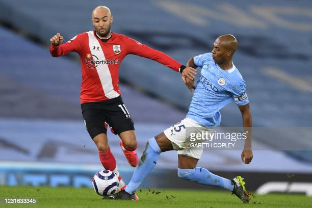 Southampton's English midfielder Nathan Redmond vies with Manchester City's Brazilian midfielder Fernandinho during the English Premier League...
