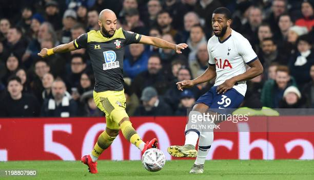 Southampton's English midfielder Nathan Redmond vies with Tottenham Hotspur's English midfielder Japhet Tanganga during the English FA Cup fourth...