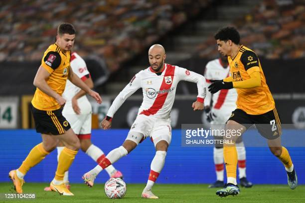 Southampton's English midfielder Nathan Redmond vies with Wolverhampton Wanderers' Belgian midfielder Leander Dendoncker and Wolverhampton Wanderers'...