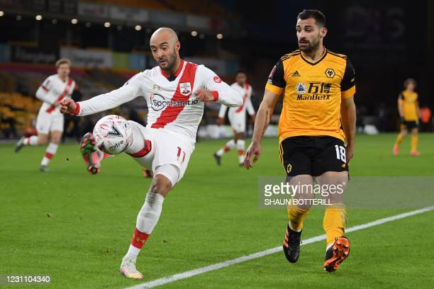Southampton's English midfielder Nathan Redmond vies with Wolverhampton Wanderers' Spanish defender Jonny Otto during the English FA Cup fifth round...