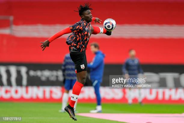 Southampton's English midfielder Nathan Tella warms up ahead of the English Premier League football match between Southampton and Chelsea at St...