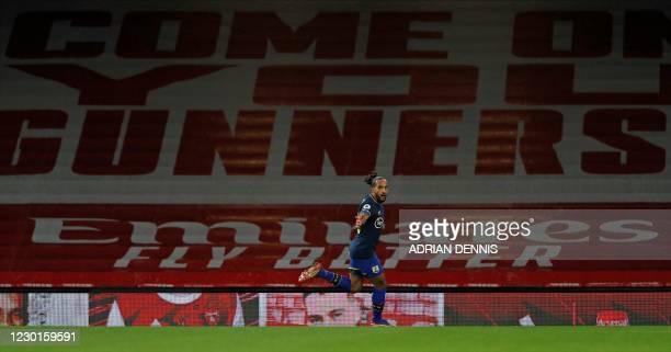 Southampton's English midfielder Theo Walcott celebrates scoring the opening goal during the English Premier League football match between Arsenal...