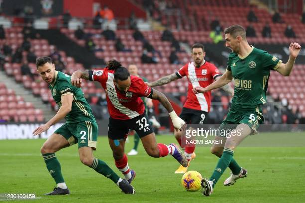 Southampton's English midfielder Theo Walcott loses his footing as he closes in on goal during the English Premier League football match between...