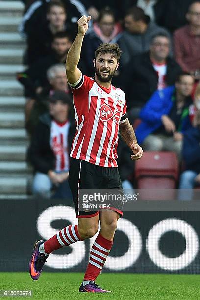 Southampton's English striker Charlie Austin celebrates after scoring the opening goal of the English Premier League football match between...