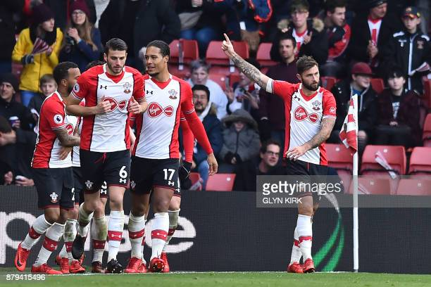 Southampton's English striker Charlie Austin celebrates after scoring their second goal during the English Premier League football match between...