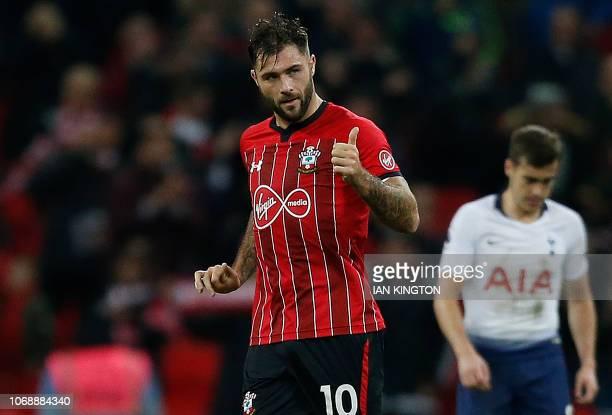 Southampton's English striker Charlie Austin celebrates scoring his team's first goal during the English Premier League football match between...
