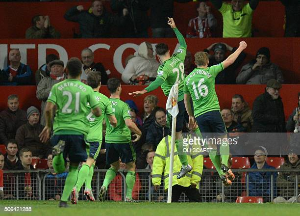 Southampton's English striker Charlie Austin celebrates scoring the opening goal during the English Premier League football match between Manchester...
