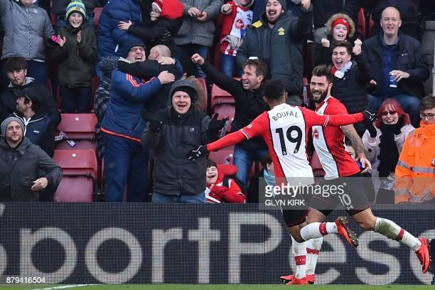 Southampton's English striker Charlie Austin celebrates with Southampton's Moroccan midfielder Sofiane Boufal after scoring their third goal during...