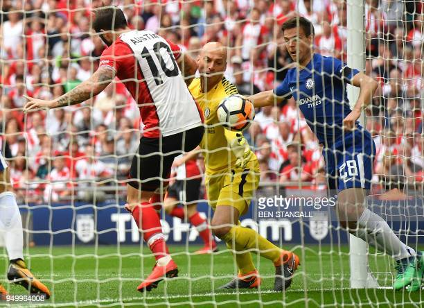 Southampton's English striker Charlie Austin fouls Chelsea's Argentinian goalkeeper Willy Caballero during the English FA Cup semifinal football...