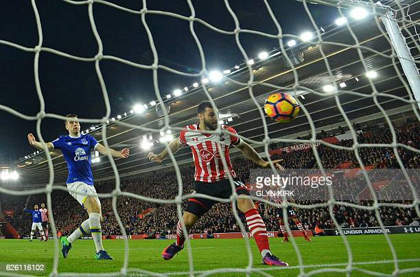 Southampton's English striker Charlie Austin heads in the opening goal in the first minute of the English Premier League football match between...