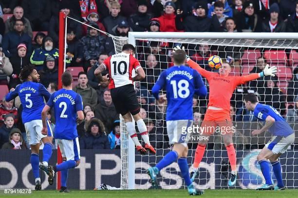 Southampton's English striker Charlie Austin heads past Everton's English goalkeeper Jordan Pickford to score their third goal during the English...