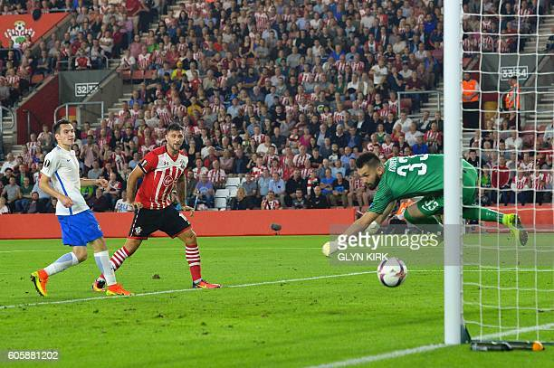 Southampton's English striker Charlie Austin heads the ball to score their second goal during the UEFA Europa League group K football match between...