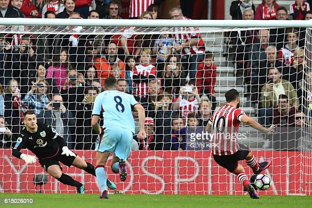Southampton's English striker Charlie Austin scores their third goal from the penalty spot during the English Premier League football match between...