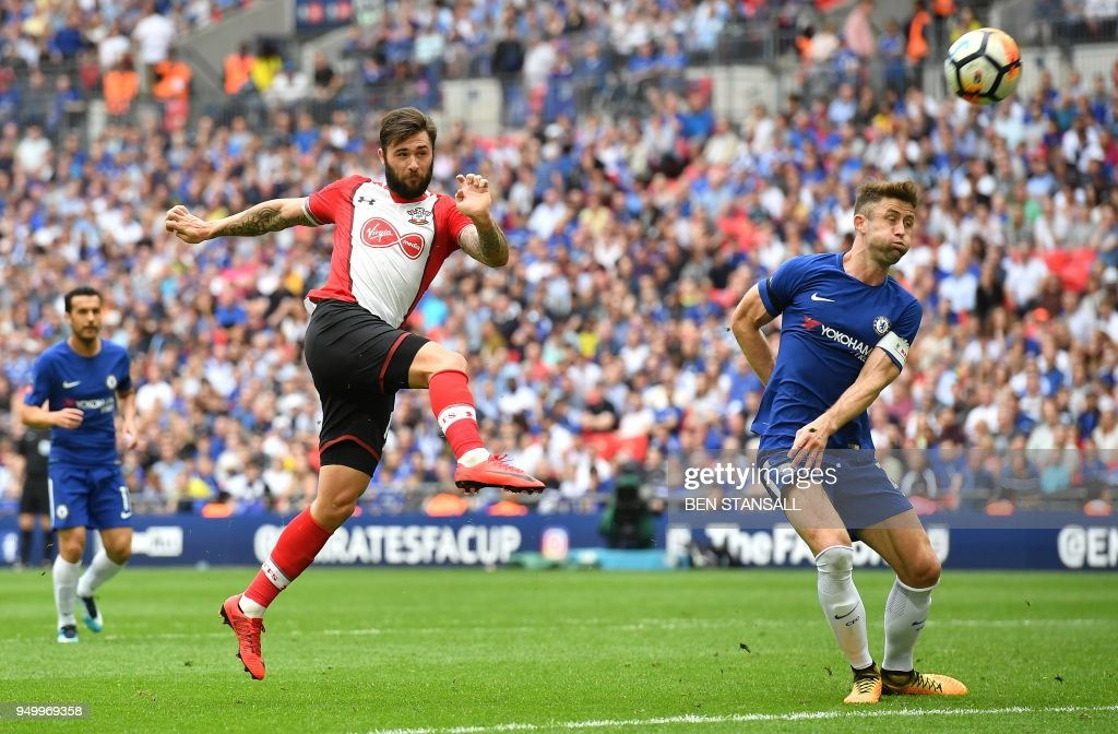 Southampton's English striker Charlie Austin shoots but fails to score during the English FA Cup semi-final football match between Chelsea and Southampton at Wembley Stadium in London, on April 22, 2018. (Photo by Ben STANSALL / AFP) / NOT