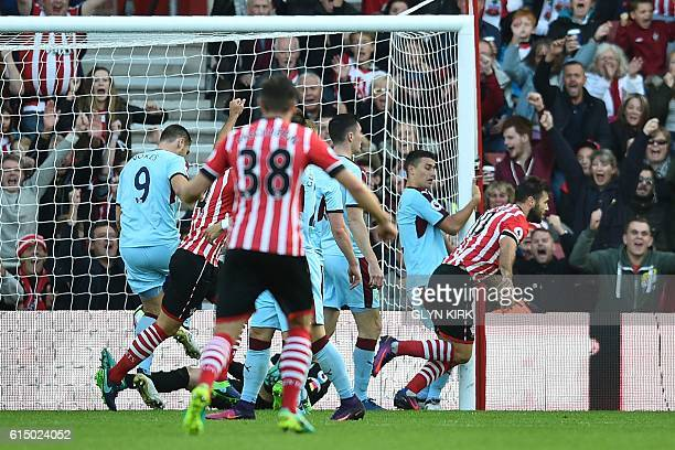 Southampton's English striker Charlie Austin turns away to celebrate after scoring the opening goal of the English Premier League football match...