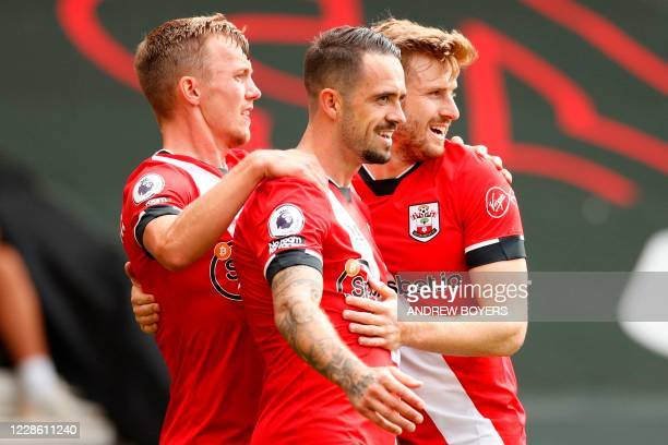 Southampton's English striker Danny Ings celebrates with teammates after scoring the opening goal of the English Premier League football match...