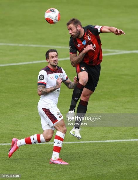 Southampton's English striker Danny Ings fights for the ball with Bournemouth's English defender Steve Cook during the English Premier League...