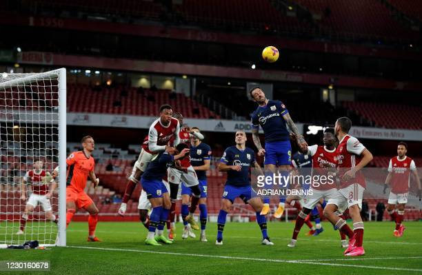 Southampton's English striker Danny Ings jumps to head the ball from a corner kick during the English Premier League football match between Arsenal...