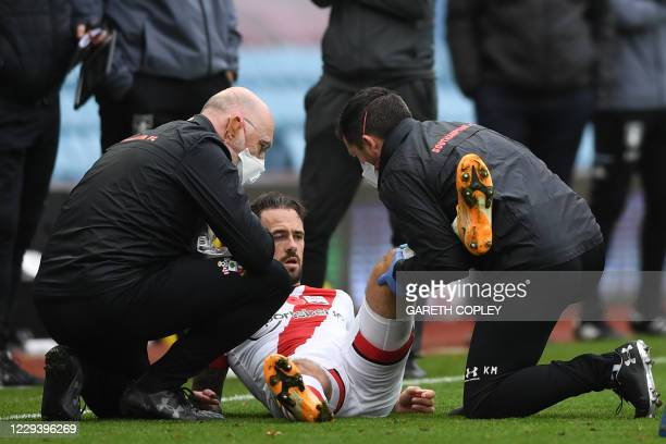 Southampton's English striker Danny Ings receives medical attention during the English Premier League football match between Aston Villa and...