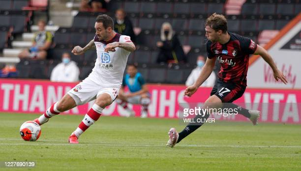 Southampton's English striker Danny Ings shoots and scores a goal during the English Premier League football match between Bournemouth and...