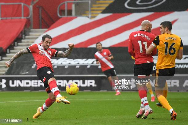 Southampton's English striker Danny Ings shoots to score the opening goal of the English Premier League football match between Southampton and...