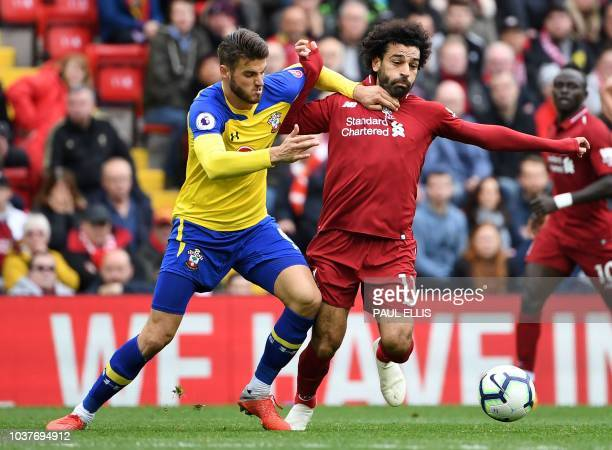Southampton's English striker Danny Ings vies with Liverpool's Egyptian midfielder Mohamed Salah during the English Premier League football match...