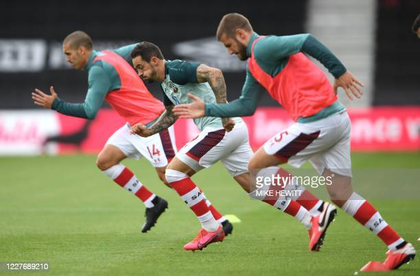 Southampton's English striker Danny Ings warm up the English Premier League football match between Bournemouth and Southampton at the Vitality...