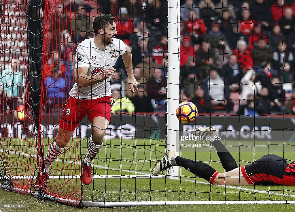 Southampton's English striker Jay Rodriguez celebrates scoring his team's second goal during the English Premier League football match between Bournemouth and Southampton at the Vitality Stadium in Bournemouth, southern England on December 18, 2016. / AFP / Adrian DENNIS / RESTRICTED TO EDITORIAL USE. No use with unauthorized audio, video, data, fixture lists, club/league logos or 'live' services. Online in-match use limited to 75 images, no video emulation. No use in betting, games or single club/league/player publications. /