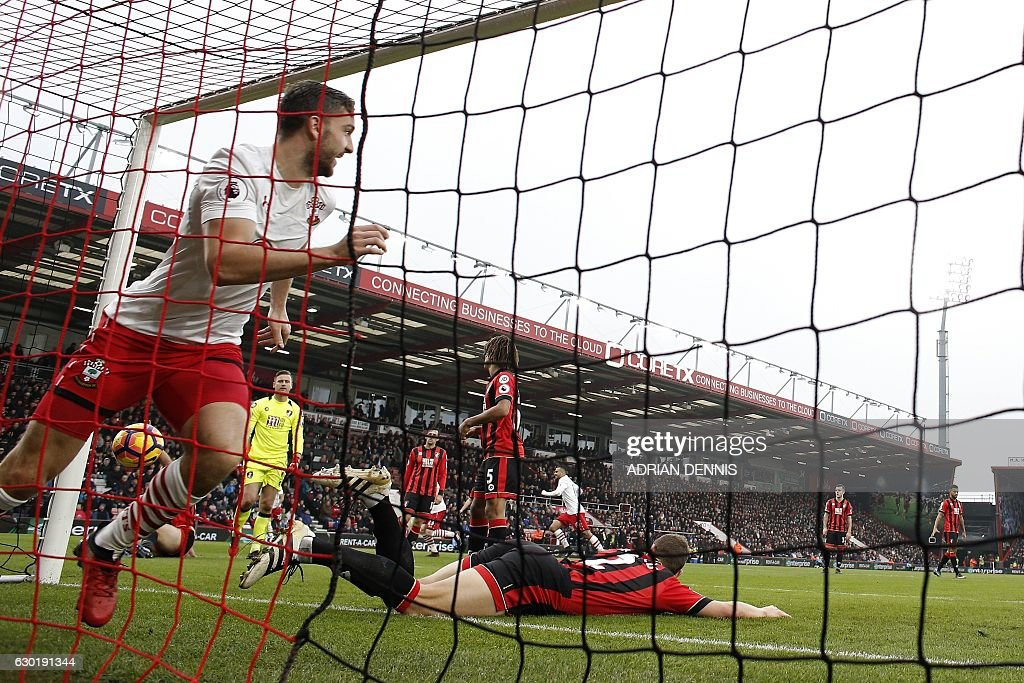 Southampton's English striker Jay Rodriguez (L) celebrates scoring his team's second goal during the English Premier League football match between Bournemouth and Southampton at the Vitality Stadium in Bournemouth, southern England on December 18, 2016. / AFP / ADRIAN DENNIS / RESTRICTED TO EDITORIAL USE. No use with unauthorized audio, video, data, fixture lists, club/league logos or 'live' services. Online in-match use limited to 75 images, no video emulation. No use in betting, games or single club/league/player publications. /