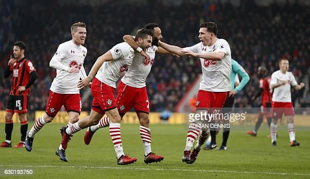 Southampton's English striker Jay Rodriguez celebrates scoring his team's third goal with Southampton's English midfielder Nathan Redmond and...