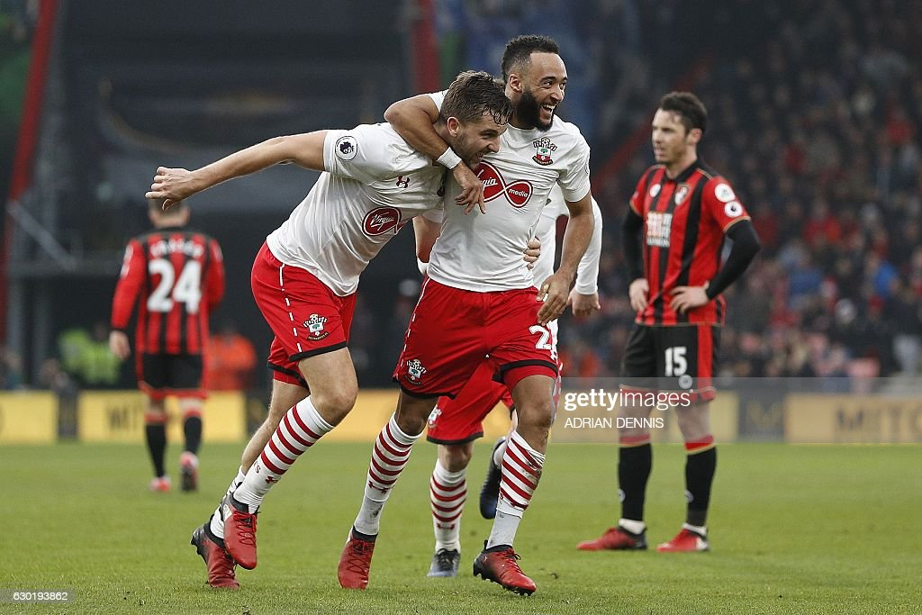 Southampton's English striker Jay Rodriguez (L) celebrates scoring his team's third goal with Southampton's English midfielder Nathan Redmond during the English Premier League football match between Bournemouth and Southampton at the Vitality Stadium in Bournemouth, southern England on December 18, 2016. / AFP / Adrian DENNIS / RESTRICTED TO EDITORIAL USE. No use with unauthorized audio, video, data, fixture lists, club/league logos or 'live' services. Online in-match use limited to 75 images, no video emulation. No use in betting, games or single club/league/player publications. /