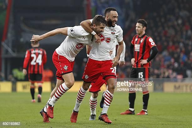 Southampton's English striker Jay Rodriguez celebrates scoring his team's third goal with Southampton's English midfielder Nathan Redmond during the...