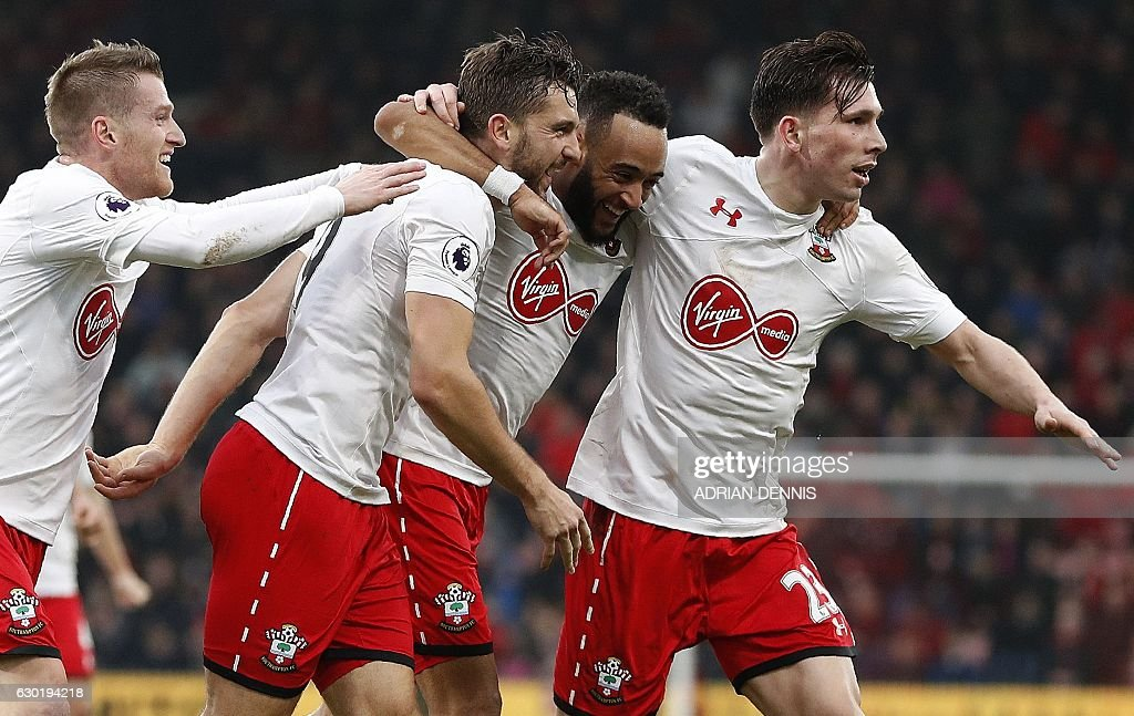 Southampton's English striker Jay Rodriguez (2L) celebrates scoring his team's third goal with Southampton's English midfielder Nathan Redmond (C) and Southampton's Danish midfielder Pierre-Emile Hojbjerg during the English Premier League football match between Bournemouth and Southampton at the Vitality Stadium in Bournemouth, southern England on December 18, 2016. / AFP / Adrian DENNIS / RESTRICTED TO EDITORIAL USE. No use with unauthorized audio, video, data, fixture lists, club/league logos or 'live' services. Online in-match use limited to 75 images, no video emulation. No use in betting, games or single club/league/player publications. /