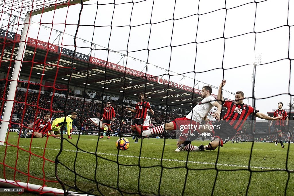 Southampton's English striker Jay Rodriguez (C) scores his team's second goal during the English Premier League football match between Bournemouth and Southampton at the Vitality Stadium in Bournemouth, southern England on December 18, 2016. / AFP / ADRIAN DENNIS / RESTRICTED TO EDITORIAL USE. No use with unauthorized audio, video, data, fixture lists, club/league logos or 'live' services. Online in-match use limited to 75 images, no video emulation. No use in betting, games or single club/league/player publications. /