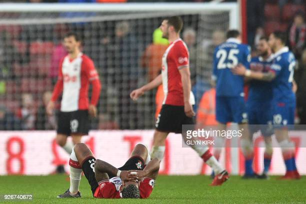 Southampton's Gabonese midfielder Mario Lemina and players react at the final whistle during the English Premier League football match between...