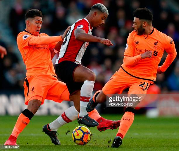 Southampton's Gabonese midfielder Mario Lemina is challenged by Liverpool's Brazilian midfielder Roberto Firmino and Liverpool's English midfielder...