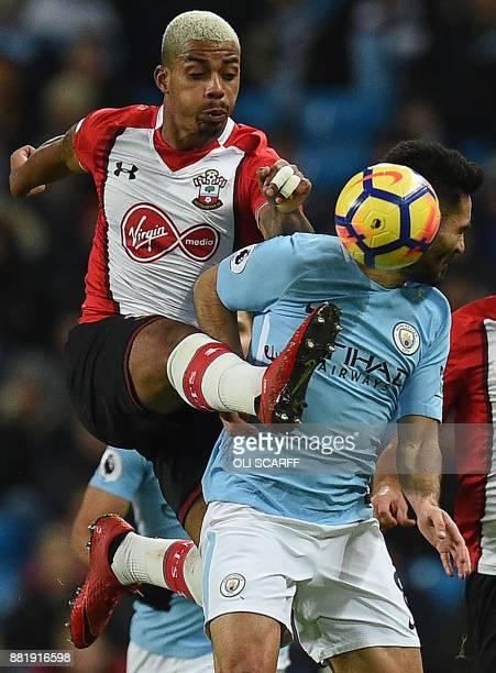 Southampton's Gabonese midfielder Mario Lemina vies with Manchester City's German midfielder Ilkay Gundogan during the English Premier League...