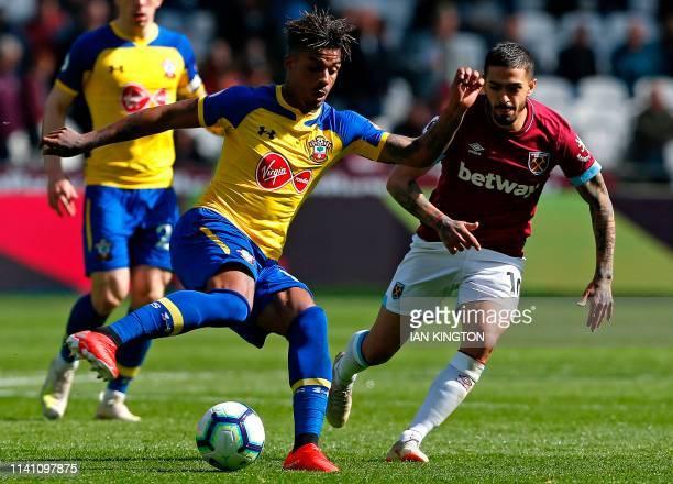 Southampton's Gabonese midfielder Mario Lemina vies with West Ham United's Argentinian midfielder Manuel Lanzini during the English Premier League...