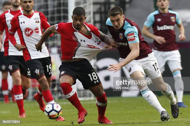 TOPSHOT Southampton's Gabonese midfielder Mario Lemina vies with West Ham United's English striker Jordan Hugill during the English Premier League...