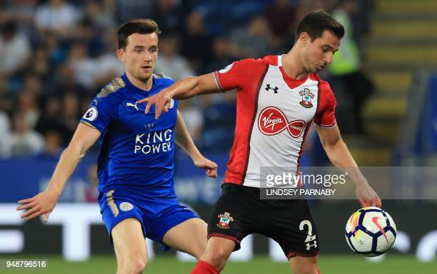 Southampton's Germanborn Portuguese defender Cedric Soares vies with Leicester City's English defender Ben Chilwell during the English Premier League...
