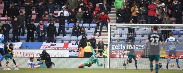 Southampton's Germanborn Portuguese defender Cedric Soares watches his shot beat Wigan Athletic's English goalkeeper Christian Walton for their...