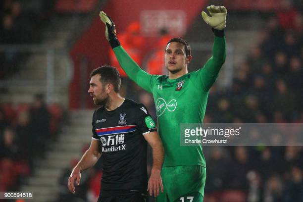 Southampton's goal keeper Alex McCarthy and Palace's James McArthur get ready for the corner during during the Premier League match between...