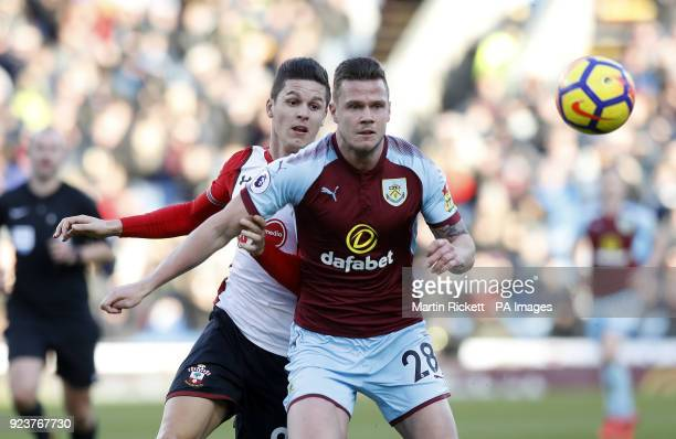 Southampton's Guido Carrillo and Burnley's Kevin Long battle for the ball during the Premier League match at Turf Moor Burnley
