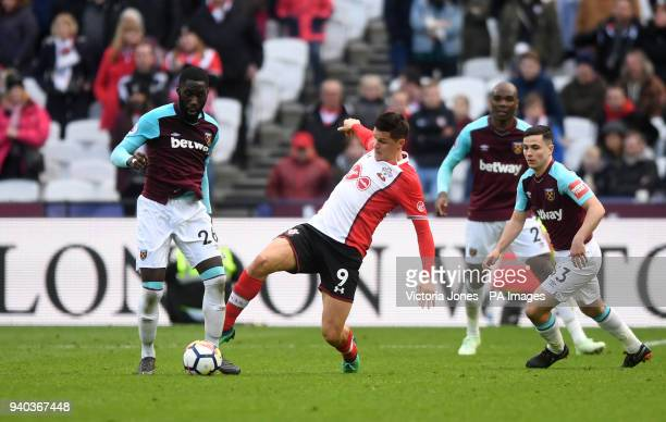 Southampton's Guido Carrillo battles for the ball with West Ham United's Arthur Masuaku and West Ham United's Josh Cullen during the Premier League...