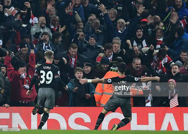 Southampton's Irish striker Shane Long celebrates scoring his team's first goal during the EFL Cup semifinal secondleg football match between...