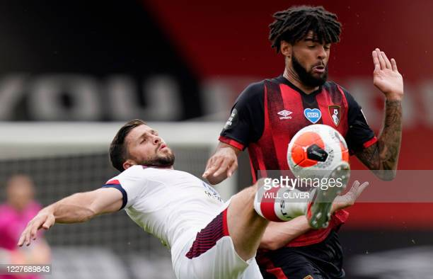 Southampton's Irish striker Shane Long fights for the ball with Bournemouth's Danish midfielder Philip Billing during the English Premier League...