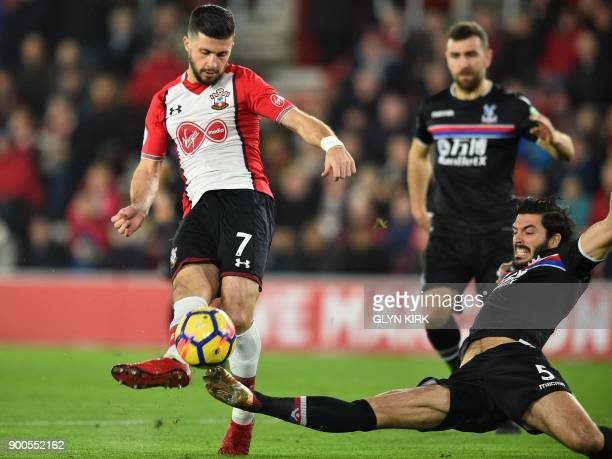 Southampton's Irish striker Shane Long has an unsuccessful shot as Crystal Palace's English defender James Tomkins attempts to block during the...