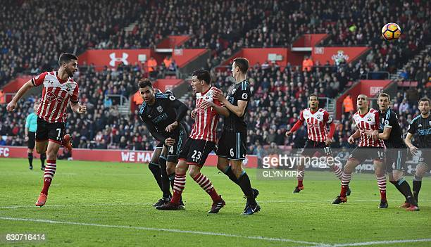 Southampton's Irish striker Shane Long heads the ball to scores his team's first goal during the English Premier League football match between...